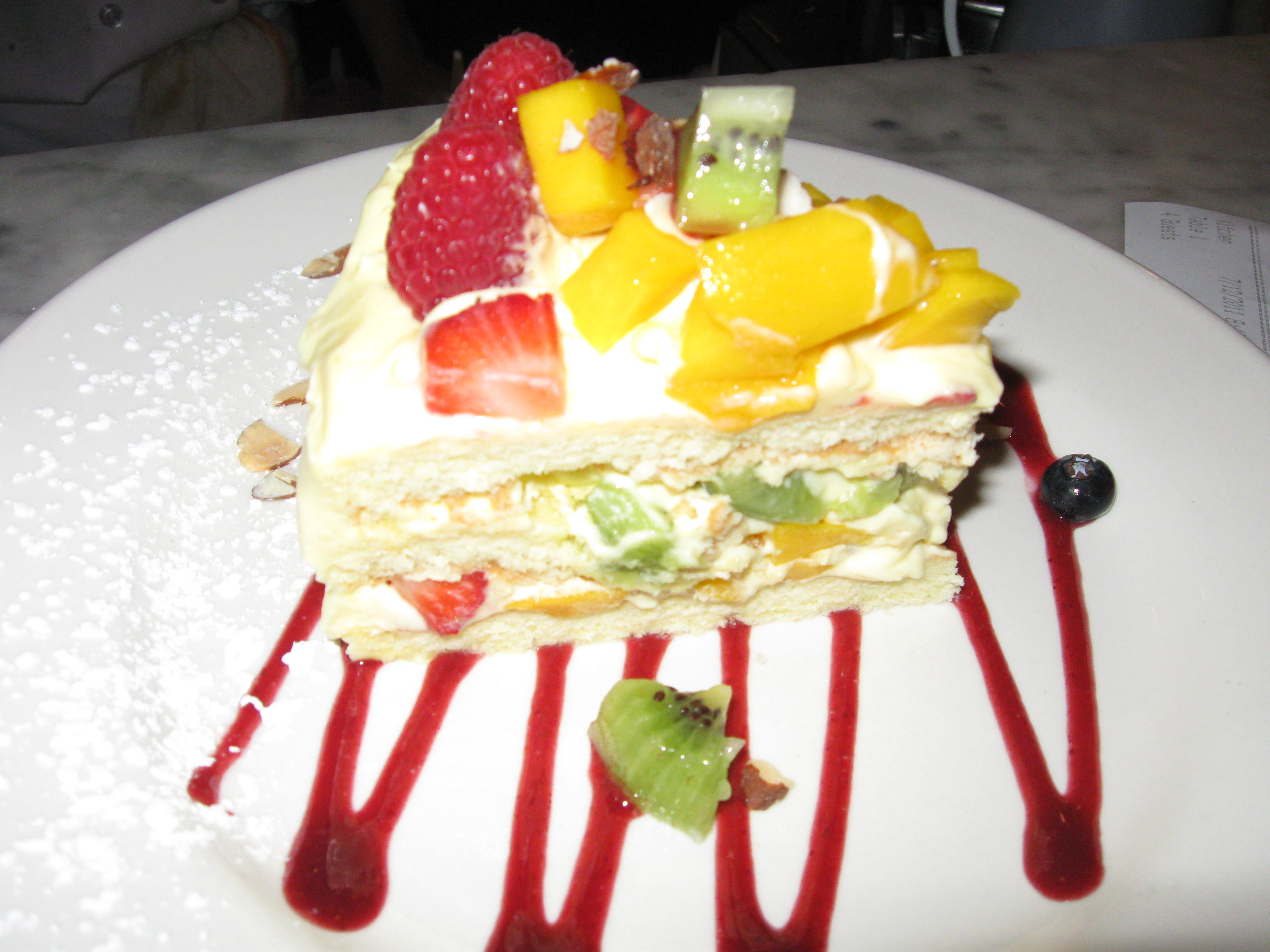 vanilla mousse cake with fresh fruit & almonds